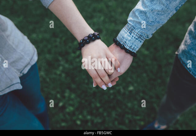 Happy couple holding hands - Stock Image