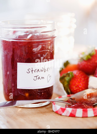 Jar of strawberry jam - Stock Image