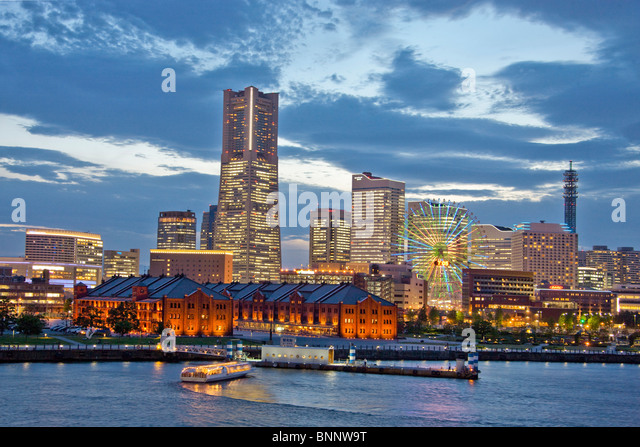 Japan Asia Far East Tokyo building construction Yokohama land mark of Building harbour port boats evening travel - Stock Image
