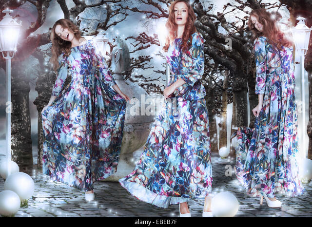 Inspiration. Fantasy. Women in Flowery Dresses among Trees - Stock Image