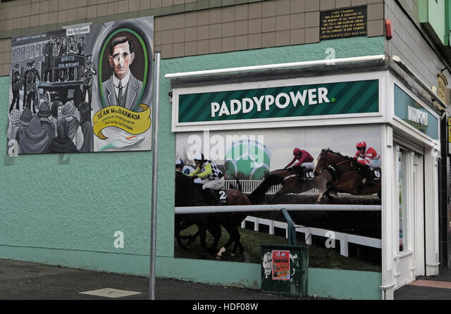Belfast Falls Rd Republican Mural and PaddyPower bookmakers - Stock Image
