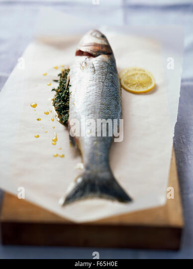 Bass with parsley and lemon - Stock Image