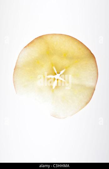 thin round slice of apple - Stock Image