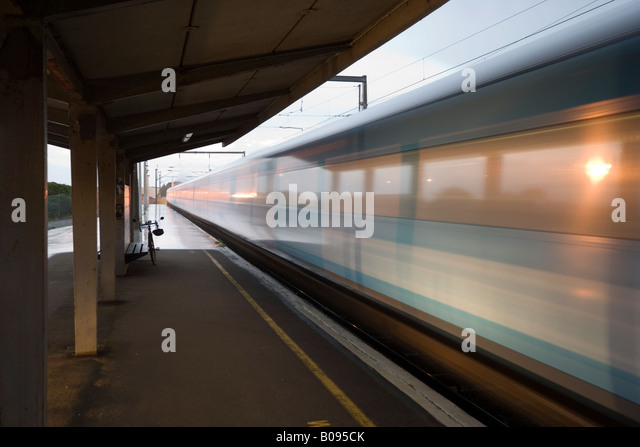 The 6.17am commuter train for Wellington on a rainy morning at Palmerston North station New Zealand - Stock Image