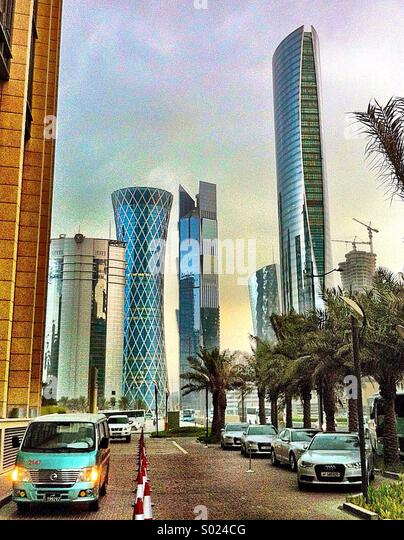 Futuristic skyline of Doha, Qatar, from entrance to Marriott Renaissance and Courtyard hotels - Stock Image
