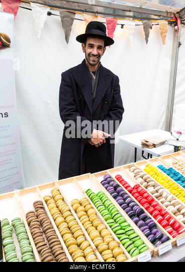 Market stall selling macaroons at the Christmas Food Festival, Abergavenny, Wales, UK - Stock Image
