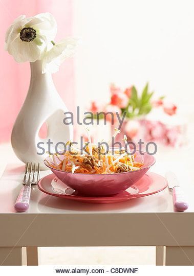 Grated carrot,bean sprout and walnut salad - Stock Image