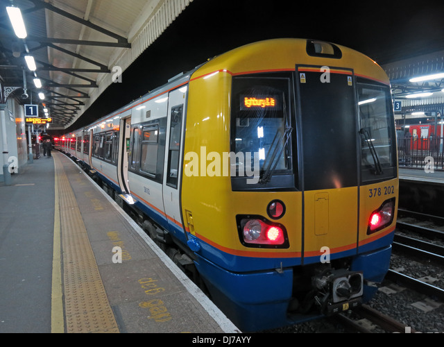 South West London Overground train at Clapham Junction at night no 378202 England UK - Stock Image