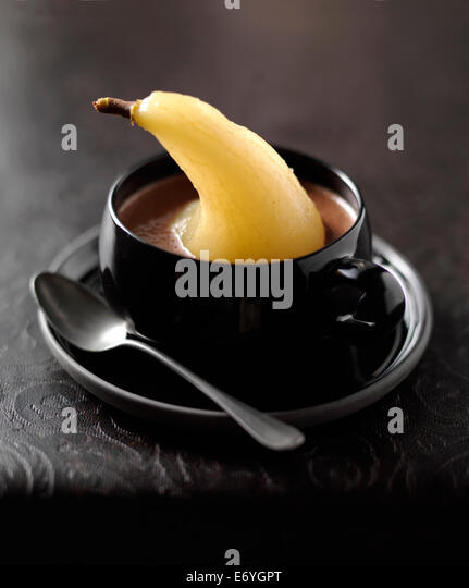 Chocolate soup with a poached pear - Stock Image