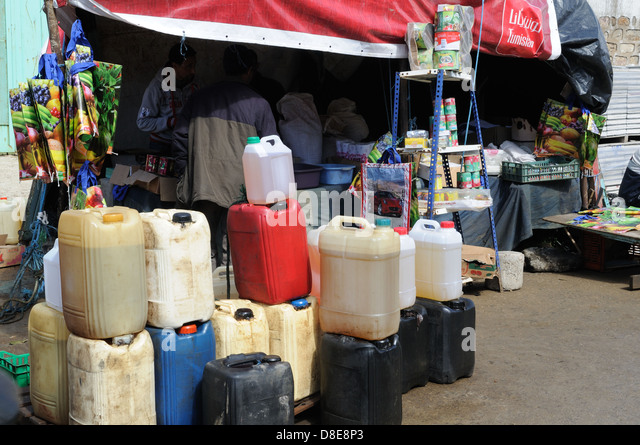 Plastic drums of petrol brought in illegally from Algeria and sold in Ain Draham market Tunisia - Stock Image