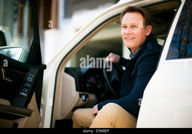 Man pleased to get to destination - Stock-Bilder