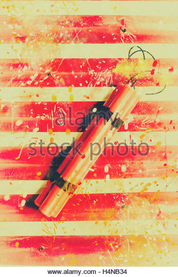 Comic stylised photo on a fiery bomb explosion with sparks spraying over a red and white background. Impact blast - Stock Image