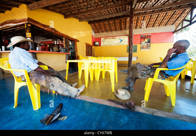 Traditional 'Pantaneiros' in a bar in the transpantaneira road, kilometer 32, Mato Grosso, Brazil - Stock Image