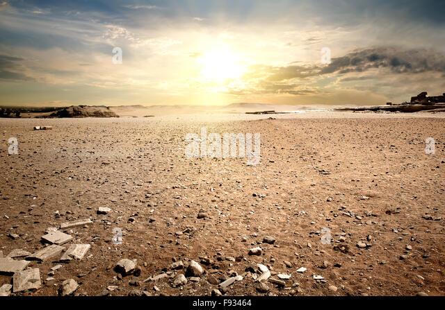 Cloudy sky in stony desert of Egypt - Stock Image