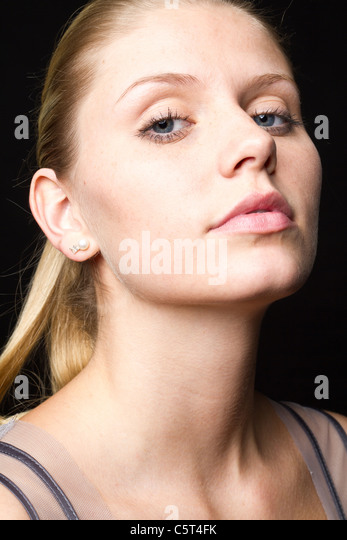 Portrait of young woman, close up - Stock Image