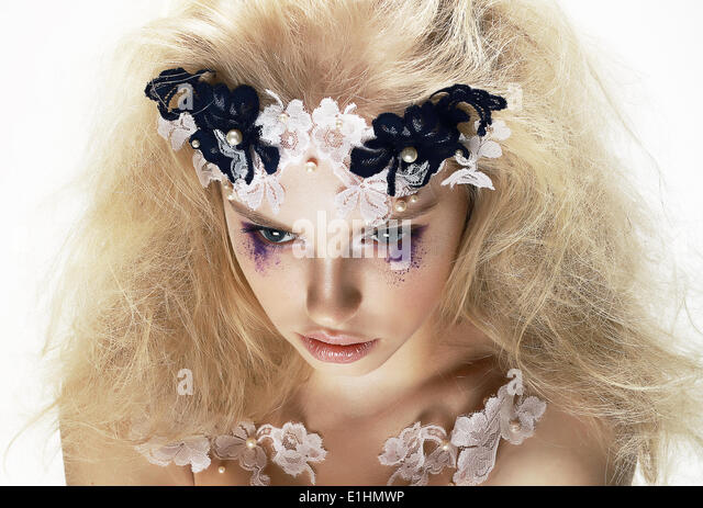 Enigma. Overhead View of Unusual Artistic Trendy Blond Woman. Creativity - Stock Image