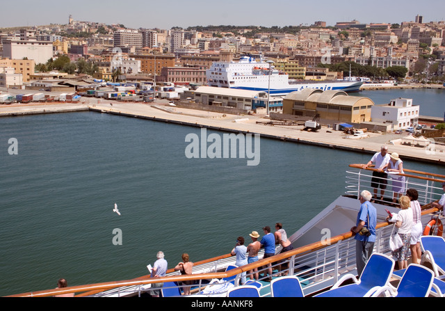 Cruse Ship Passengers watch their arrival in Cagliari Harbour, Sardinia, Mediterranean Sea, Europe, - Stock Image