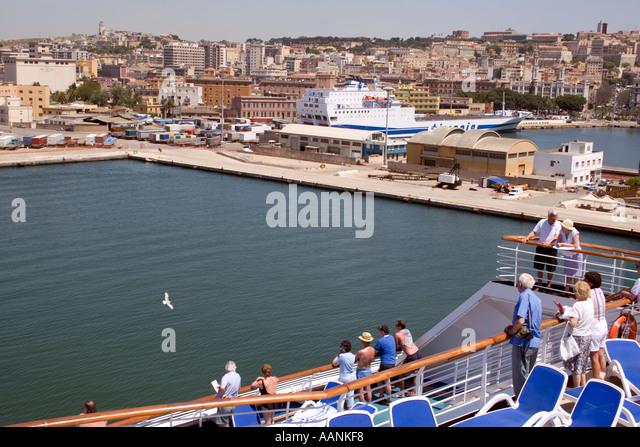 Cruse Ship Passengers watch their arrival in Cagliari Harbour, Sardinia, Mediterranean Sea, Europe, - Stock Image