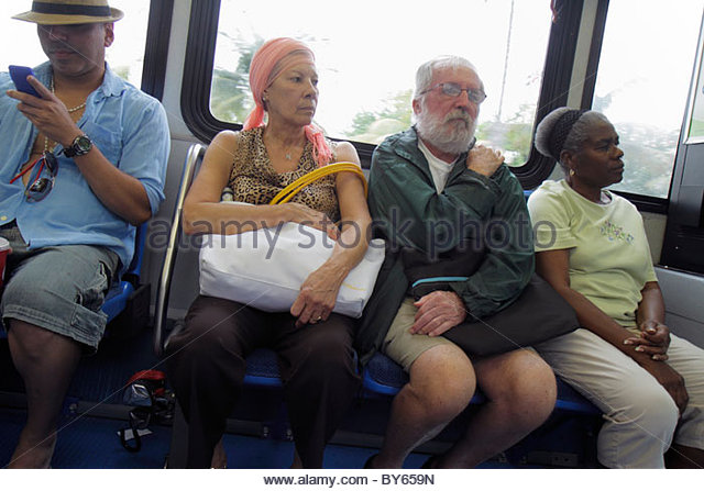 Miami Beach Florida Miami-Dade Metrobus South Beach Local passengers Black woman Hispanic man senior - Stock Image