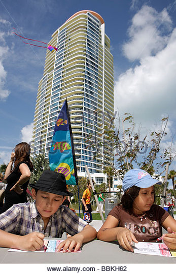 Miami Beach Florida South Pointe Park Grand Reopening event playground Hispanic boy girl child siblings drawing - Stock Image