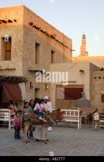 Qatar Doha Souk children on donkey - Stock Image