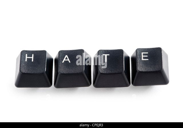 computer keys isolated on white spelling the word hate - Stock Image