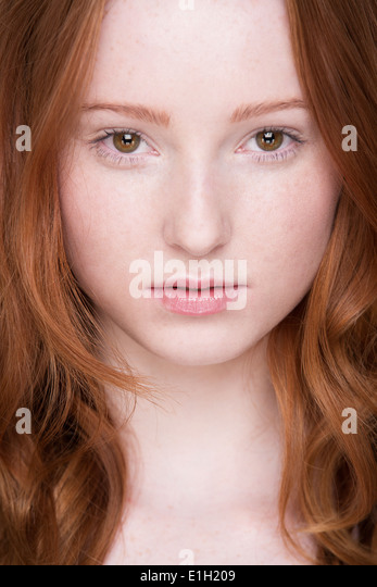 Close up portrait of young woman, looking at camera - Stock Image