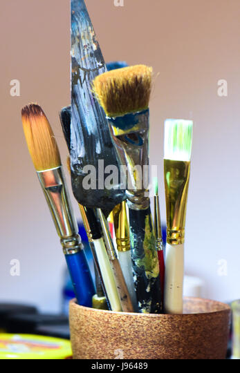 Colorful paintbrushes standing in a cup. - Stock Image