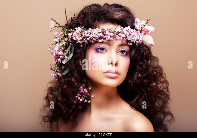 Luxuriant. Femininity. Fashion Model with Classic Wreath of Flowers - Stock Image