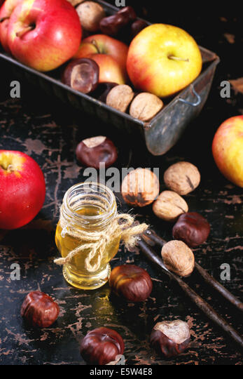 Honey, nuts and apples - Stock Image