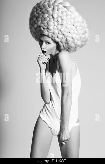 Glamor. Image of Fashion Model In Unusual Wig in Artistic Pose - Stock Image