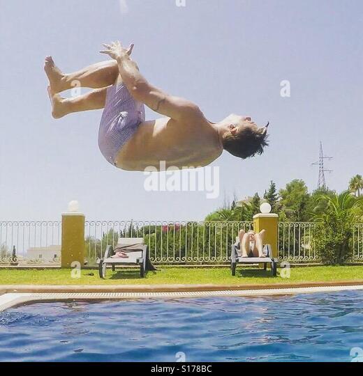 Pool acrobatics - Stock-Bilder