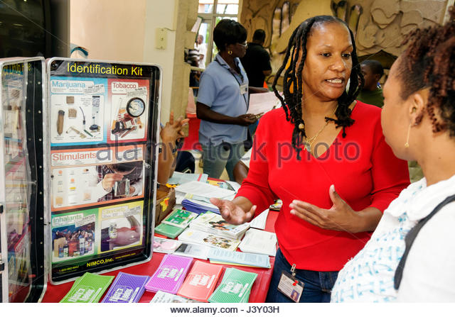 Miami Florida Liberty City Jessie Trice Community Health Center fair free care volunteer poster education information - Stock Image