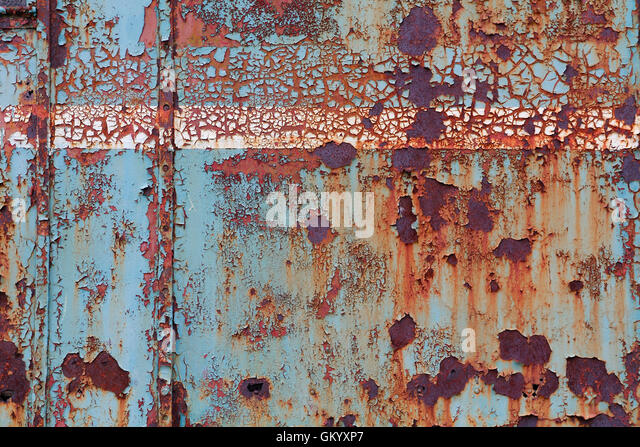 Old corroded steel surface, with cracked paint - Stock Image