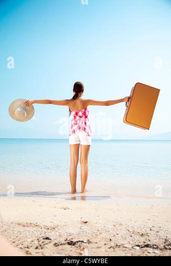 happy holiday maker arrives at destination - Stock-Bilder
