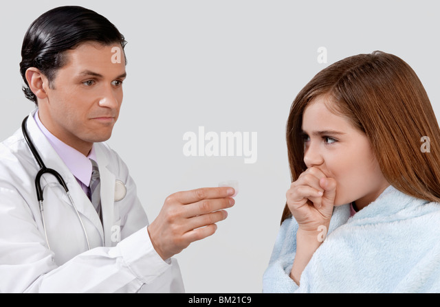 Doctor giving medicine to a girl - Stock Image