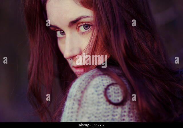 Young woman with serious expression, portrait - Stock Image