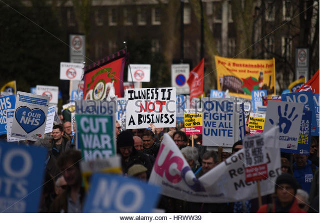 'Our NHS' was the name given to a protest march demonstrating against the cuts to and privatisation of the - Stock Image