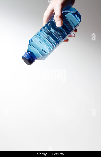 Hand holding a water bottle - Stock Image