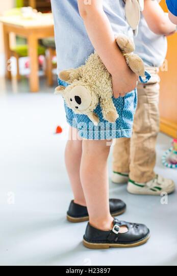 Girl in kindergarten. - Stock Image