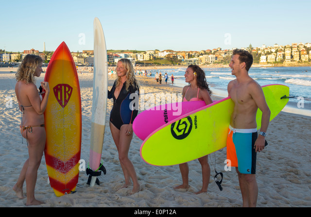 Australia NSW New South Wales Sydney Bondi Beach Pacific Ocean surf waves sand public North Bondi surfers surfer - Stock Image