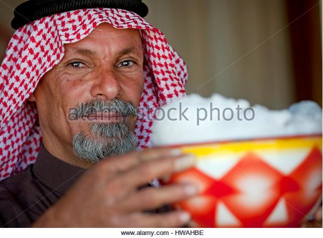 Saudi Arabia, Riyadh Province, Riyadh, Saudi Beduin With Fresh Camel Milk - Stock Image