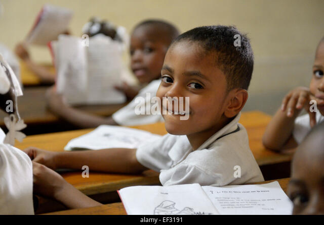 Schoolboy in class at the Basile Moreau Primary School, Carrefour, Port-au-Prince, Ouest Department, Haiti - Stock Image