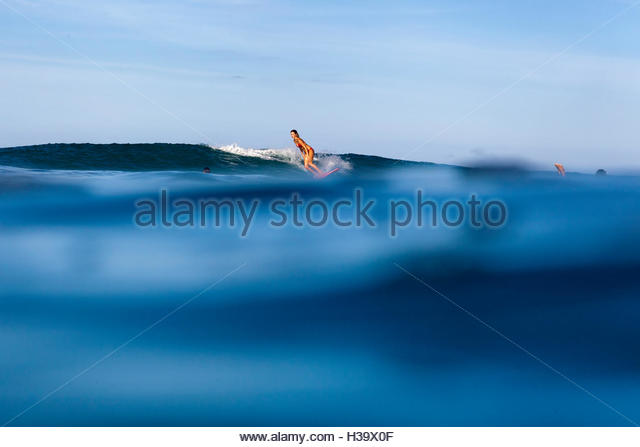 young woman surfing - Stock Image