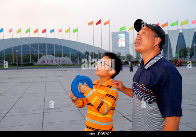 Shanghai China Pudong Xin District Oriental Sports Center Asian man senior grandfather boy grandson learning teaching - Stock Image
