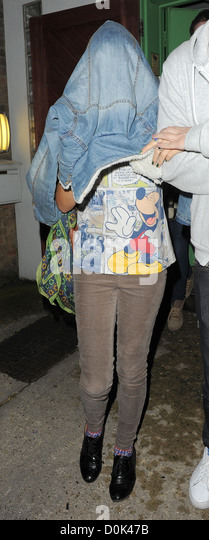 X Factor finalist Sophia Wardman chooses to hide under her jacket, as she leaves a recording studio late at night - Stock Image
