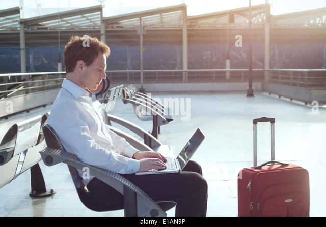 using internet in the airport terminal - Stock-Bilder
