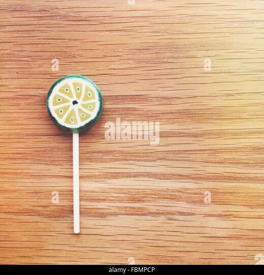 Lollipop On Wooden Table - Stock Image