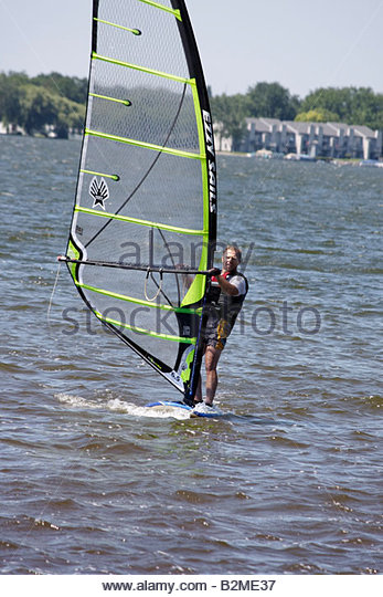 Wisconsin Kenosha Silver Lake Silver Lake Park windsurf water sport recreation sail board wind man lifejacket - Stock Image