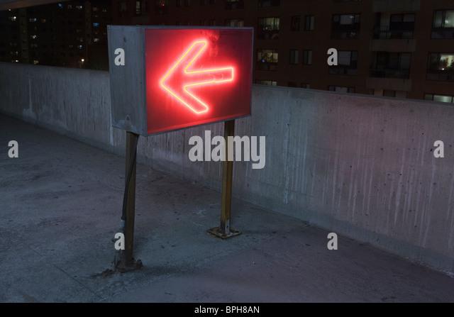 Illuminated arrow sign in a garage, Theater District, Boston, Suffolk County, Massachusetts, USA - Stock Image